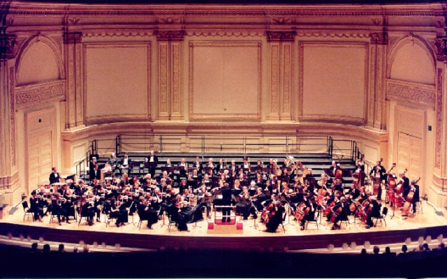 Historical photograph of the Ridgewood Symphony Orchestra performing at Carnegie Hall.