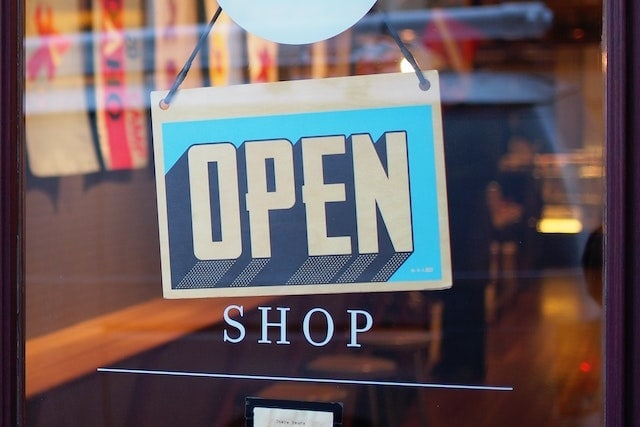 Stock photo of a business open sign.